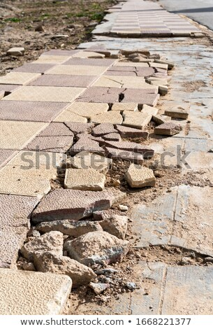 Brown Pavement with a Pattern of broken squares. Stock photo © tashatuvango