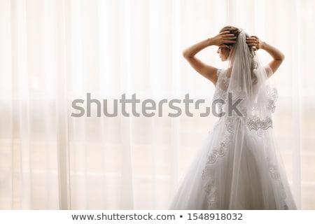Gyönyörű vörös haj menyasszony ablak virágcsokor áll Stock fotó © dariazu