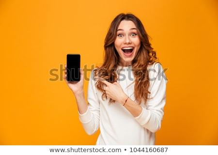 young brunette woman looking surprised stock photo © stryjek