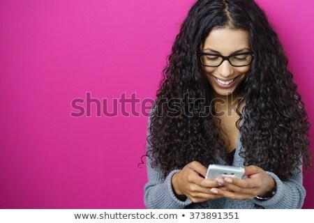 Beautiful businesswoman text messaging Stock photo © wavebreak_media