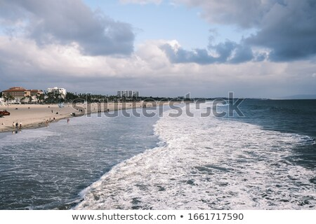 Tide coming in at pier in California Stock photo © emattil