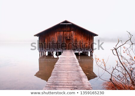 Row of wooden red boathouses in winter Stock photo © Mps197