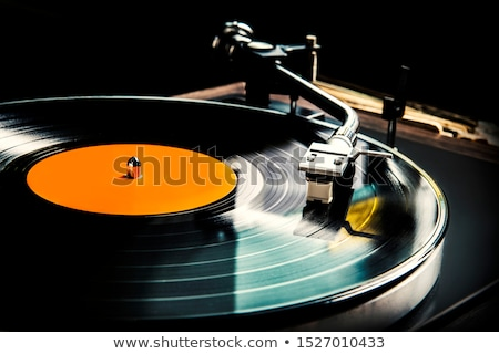 close up of vintage record player with vinyl disc stock photo © dolgachov