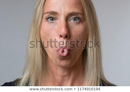 contemptuous woman sticking out her tongue stock photo © rastudio