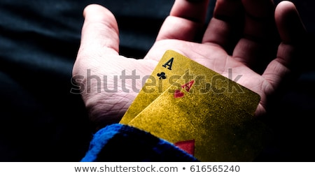 Closeup of man magician with ace in his sleeve Stock photo © deandrobot