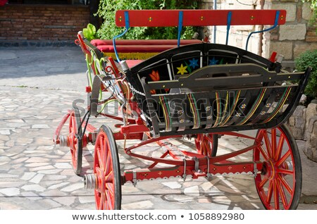 Anicent red wheel in a horse driven wagon Stock photo © AlessandroZocc
