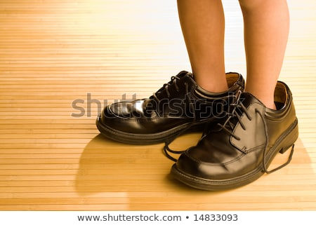 A boy fitting the big shoe Stock photo © bluering