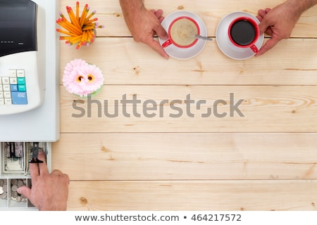 Customer tendering payment for coffee at the till Stock photo © ozgur