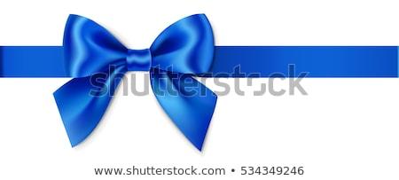 blue bow on a blue background Stock photo © blackmoon979