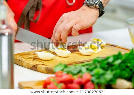 Preparing breakfast. Cutting boiled quail eggs. stock photo © user_11056481