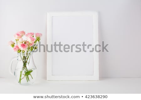 Shabby Chic Style White Frame Mockup With Pink Roses Photo stock © TasiPas