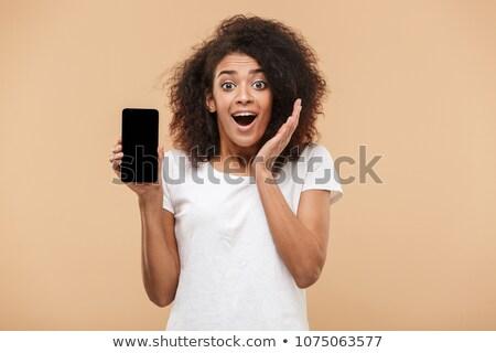 笑みを浮かべて · アフロ · アメリカン · 女性 · スマートフォン - ストックフォト © deandrobot