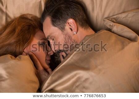 Uomo donna dormire letto amanti Foto d'archivio © popaukropa