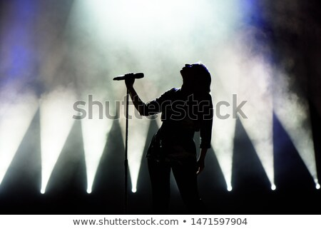 Chanteur chanter stade discothèque musique heureux Photo stock © wavebreak_media