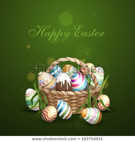 Osier panier plein œufs de Pâques herbe isolé Photo stock © orensila