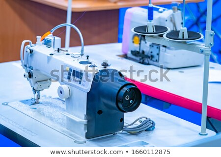 tailor hand setting spool to sewing machine Stock photo © dolgachov