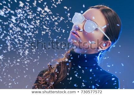 woman in sunglasses covered in frost Stock photo © LightFieldStudios