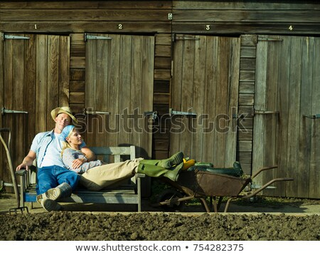 a couple relaxing in an allotment stock photo © is2