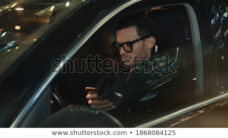 Businessman typing on Handheld Stock photo © IS2