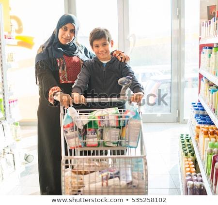 közel-keleti · nő · fiú · pláza · család · vásárlás - stock fotó © monkey_business