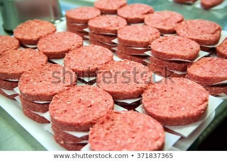 Butchers processing hamburger patty Stock photo © wavebreak_media