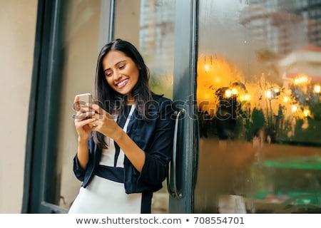 Riendo teléfono móvil pie escaleras aire libre Foto stock © deandrobot
