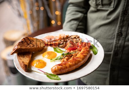 Full English breakfast on dark rusty background Stock photo © dash