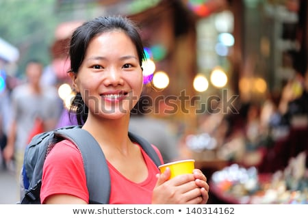 Attractive woman with ponytail and cup Stock photo © Traimak
