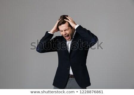 Afbeelding onzeker zakenman 30s formeel pak Stockfoto © deandrobot