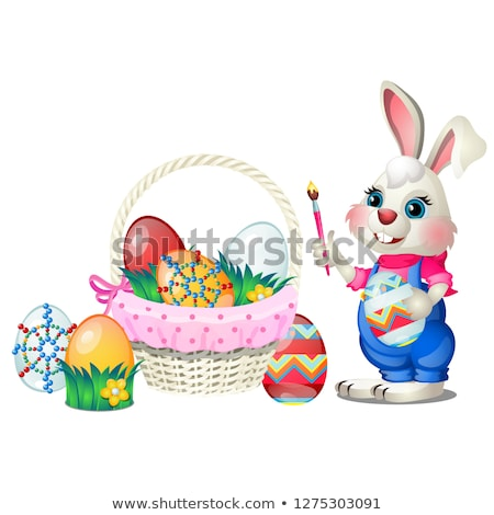 Set of colorful Easter eggs with patterns and funny animated bunny holds in paws brush isolated on w Stock photo © Lady-Luck
