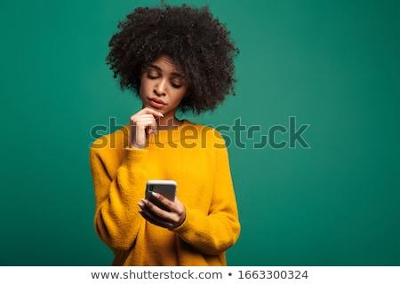 Souriant confondre jeune femme chandail écharpe Photo stock © deandrobot