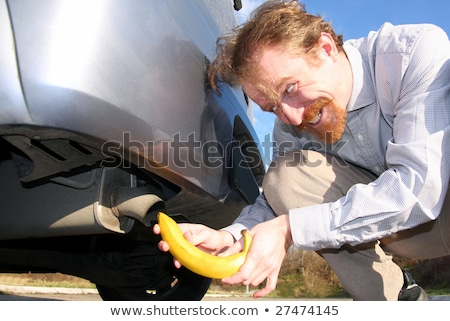Banaan uitputten man auto pijp stad Stockfoto © vladacanon