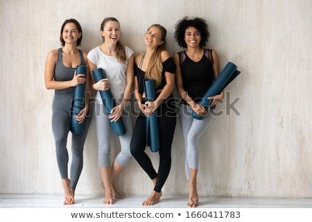 happy different race women wearing sports top and leggings stock photo © dashapetrenko