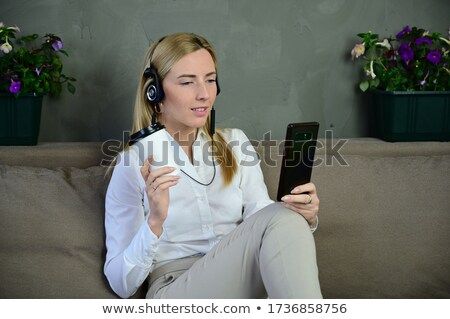 Pretty slender young woman talking on her mobile Stock photo © Giulio_Fornasar