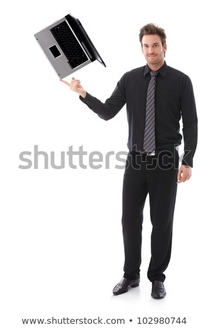 Young man balancing a laptop on his forefinger stock photo © nyul