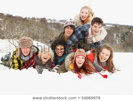 group of teenage friends having fun in snowy landscape stock photo © monkey_business