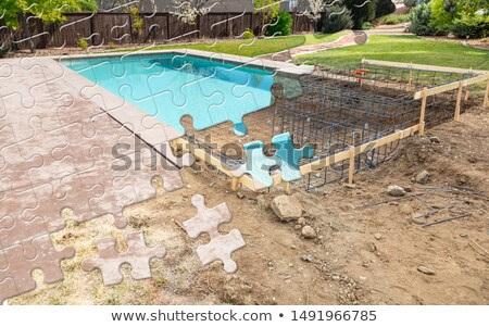 Puzzelstukjes samen afgewerkt zwembad bouwen bouw Stockfoto © feverpitch