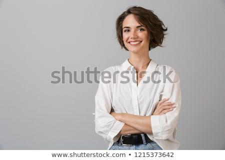 Portré fiatal nő pózol szürke mosolyog nő Stock fotó © Lopolo
