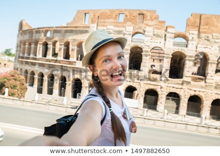 Happy Woman Pulling Her Boyfriend While Walking To Colosseum Stock photo © AndreyPopov