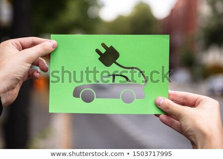 Hands Holding Paper With Cutout Electric Car Stock photo © AndreyPopov