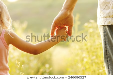 Mains âgées personne enfant générations soins Photo stock © galitskaya