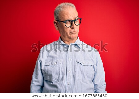Thoughtful man looking serious and frowning. Stock photo © lichtmeister