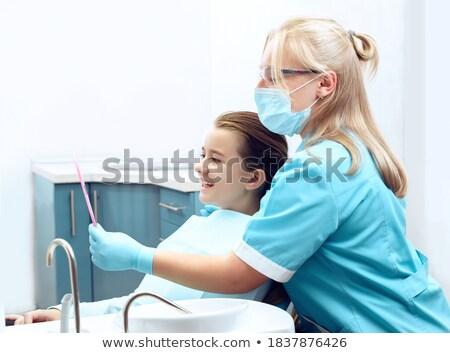 Nő fogorvos néz fogak gyermek műtét Stock fotó © Kzenon