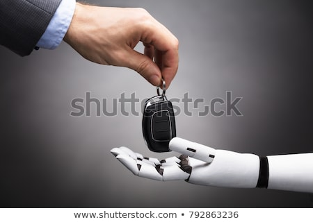 Businessperson's Hand Giving Car Key To Robot Stock photo © AndreyPopov