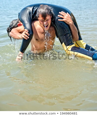 Diver rescues drowning woman Stock photo © studiostoks