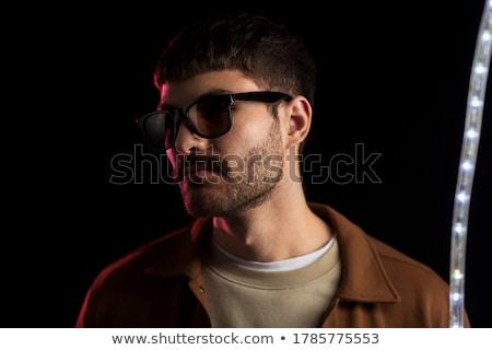 Adam güneş gözlüğü mor neon ışıklar boş Stok fotoğraf © dolgachov