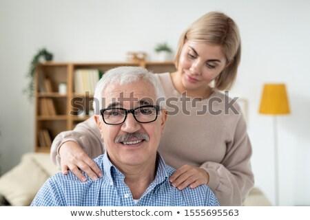 Voorzichtig jonge vrouw massage schouders senior vader Stockfoto © pressmaster