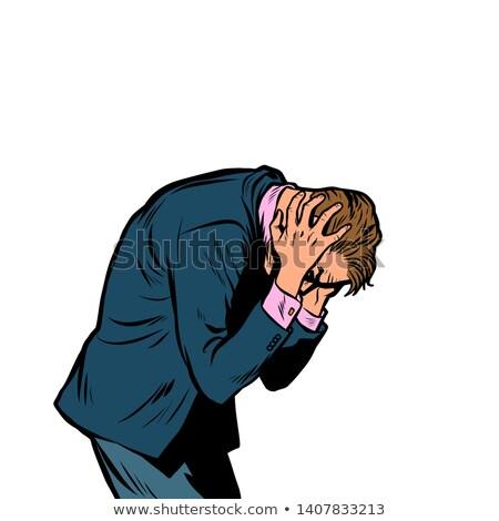 Severe headache, man clasped his head Stock photo © studiostoks