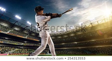 Baseball Player Swinging Bat at Ball for Home Run Stock photo © Krisdog