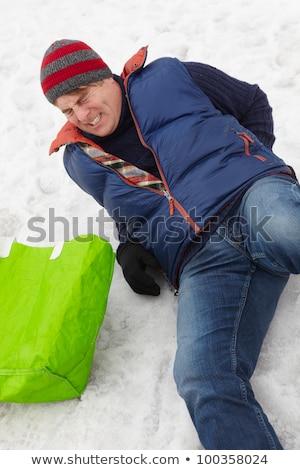 Uomo scivoloso strada inverno caldo giacca Foto d'archivio © AndreyPopov